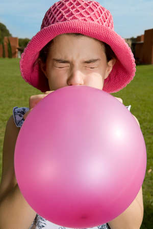 one teenage girl only: Girl blowing balloon up