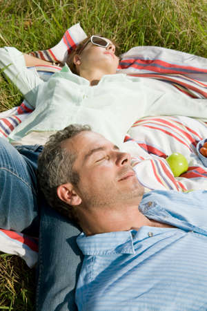 above 30: Husband and wife resting in park