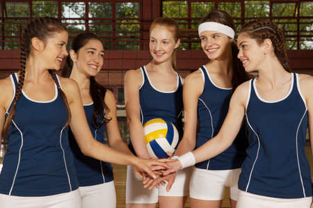 volleyball: Five young women taking an oath