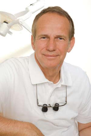 receding hairline: Portrait of a dentist smirking