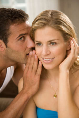 turkish ethnicity: Close-up of a young man whispering to a young woman