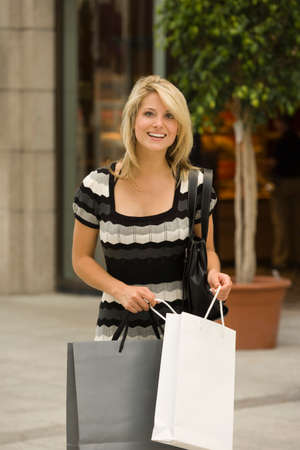 retail therapy: Young woman carrying shopping bags