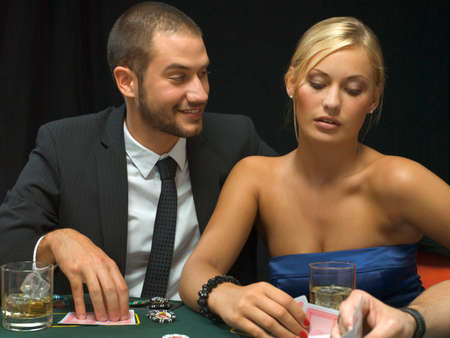poker game: Couple playing poker game LANG_EVOIMAGES