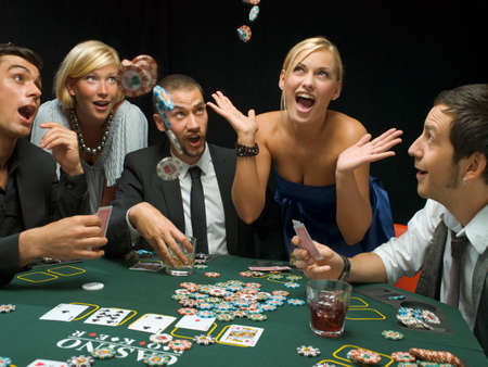 poker game: Happy woman throwing poker chips at poker game