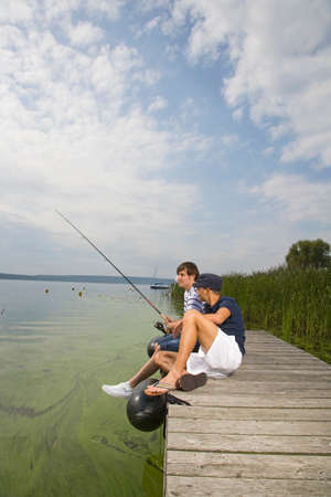 young men: Young men fishing LANG_EVOIMAGES