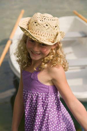european ethnicity: Young happy girl near lake