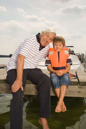 bare feet boys: Grandfather and grandson at the lake