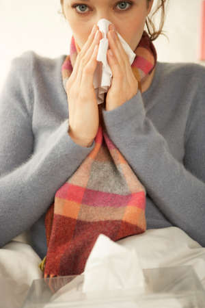 mid adult woman: Portrait of a mid adult woman suffering from cold