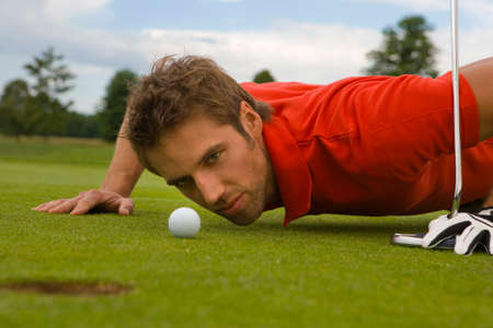 judging: Side profile of a mid adult man judging a golf ball in a golf course LANG_EVOIMAGES