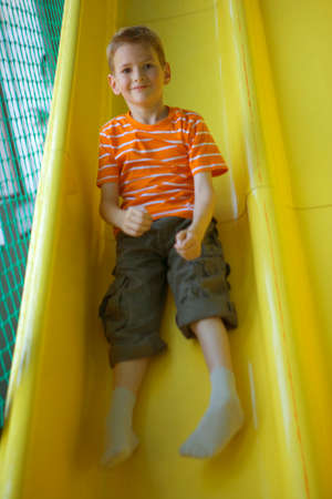 sliding: Boy sliding on a slide