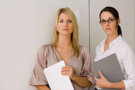 two person only: Portrait of two businesswomen standing in an office