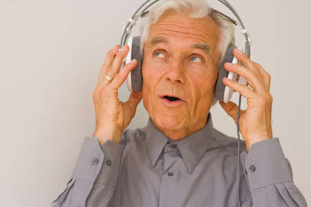 receding hairline: Close-up of a businessman listening to music