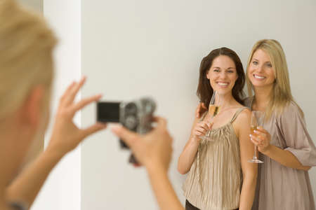 three persons only: Woman taking photo of her friends