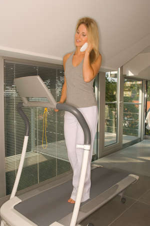off shoulder: Woman on treadmill phoning