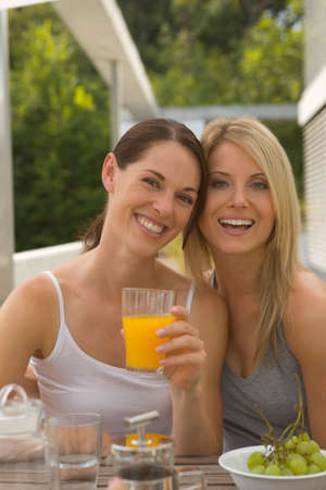 tanktop: Two women at breakfast table LANG_EVOIMAGES
