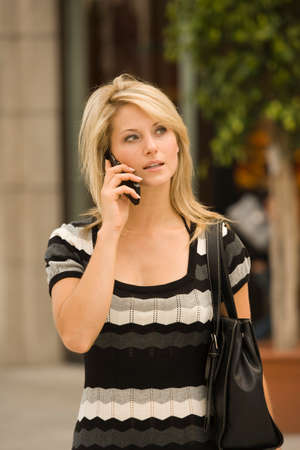 sidewalk talk: Young woman on cell phone