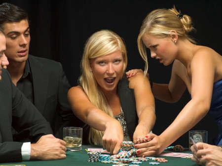 women fighting: Women fighting over poker chips