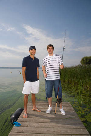 fishing pole: Young men with fishing pole LANG_EVOIMAGES