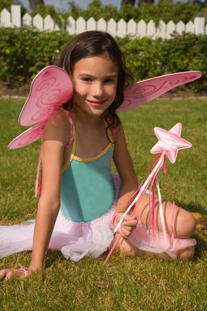 fairy wings: Portrait of young girl with fairy wings and wand LANG_EVOIMAGES