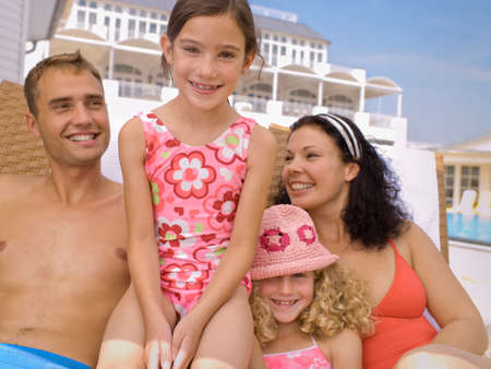 bare waist: Happy family near pool