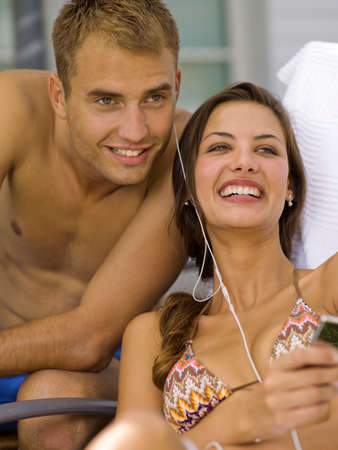 bare waist: Couple listening to music player