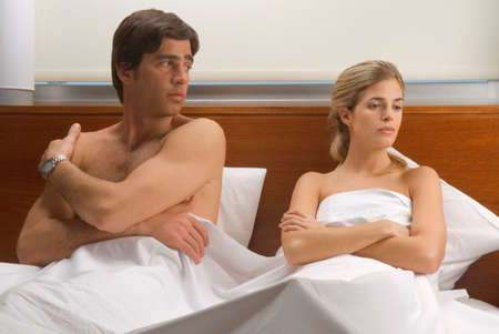 bare chested: Upset couple in bed