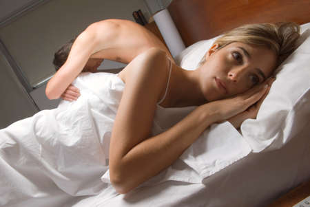 bare chested: Couple ignoring each other in bed