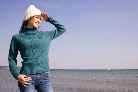 european ethnicity: Young woman on the beach looking into distance
