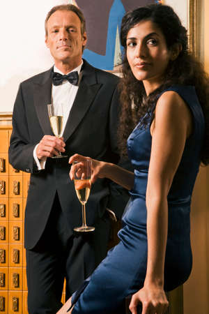 turkish ethnicity: Portrait of a mature man and a young woman holding champagne flutes