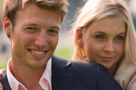 mid adult couple: Close-up of a mid adult couple smiling