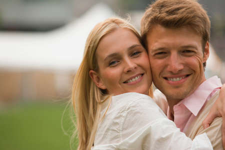 mid adult couple: Portrait of a mid adult couple embracing each other and smiling