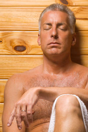 body concern: Close-up of a mature man with his eyes closed in a sauna LANG_EVOIMAGES