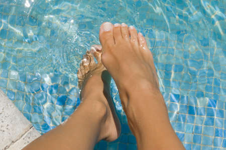low section view: Low section view of a womans feet in a swimming pool