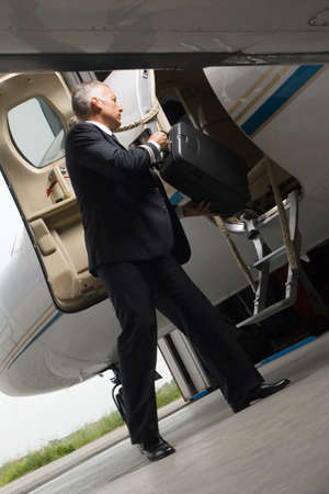 the entering: Pilot entering in a private airplane LANG_EVOIMAGES
