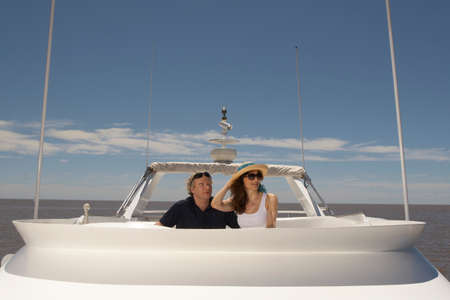 mature adult: Mature adult couple relaxing on boat LANG_EVOIMAGES