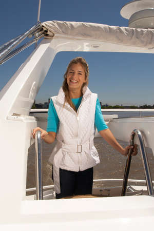 european ethnicity: Young happy woman standing on boat