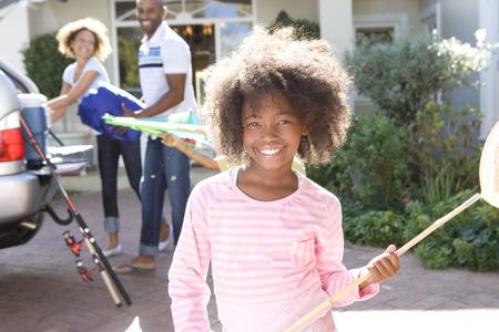 소녀 (8-10) 진원지에 그물 낚시, 부모 배경, 미소, 초상화