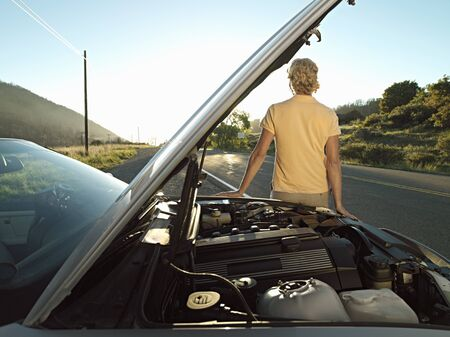engine bonnet: Man waiting beside car with open bonnet at roadside, experiencing problems with engine LANG_EVOIMAGES