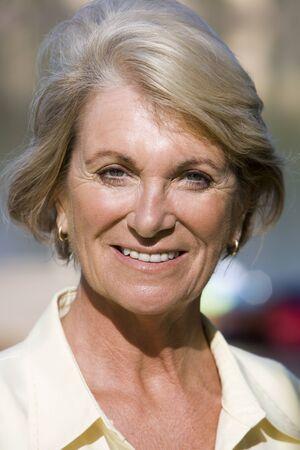 front view: Senior woman smiling, close-up, front view, portrait