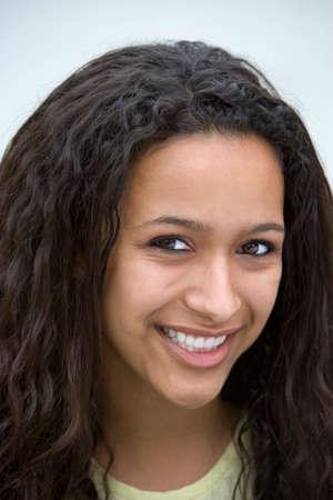front view: Woman smiling, front view, close-up, portrait LANG_EVOIMAGES