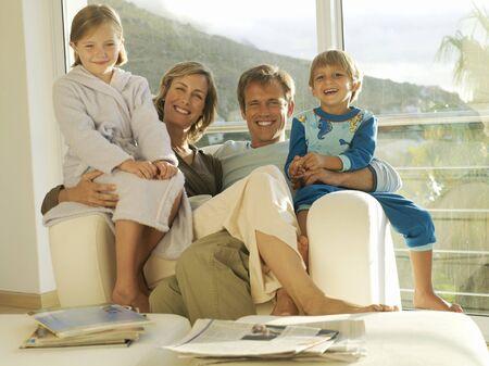 two generation family: Two generation family relaxing in armchair beside balcony sliding doors, smiling, portrait LANG_EVOIMAGES
