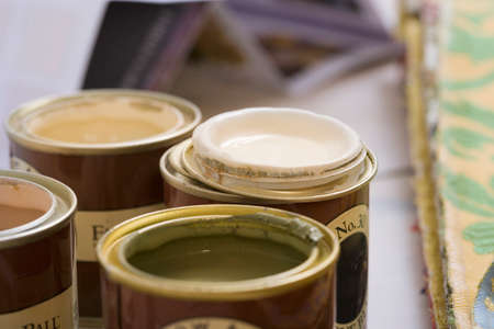 differential: Close-up of tins of paint (differential focus)