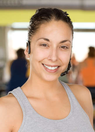 only mid adult women: Woman wearing headset, smiling, portrait LANG_EVOIMAGES