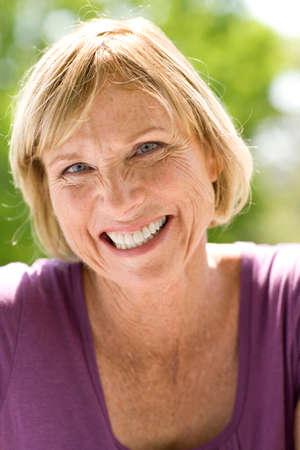 oudoors: Mature woman oudoors, smiling, portrait