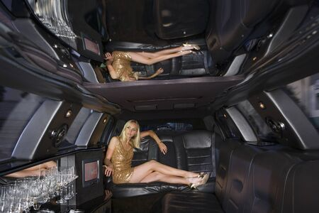 full length mirror: Young woman in limousine, legs crossed