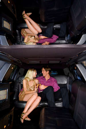 full length mirror: Young couple in limousine, smiling at each other
