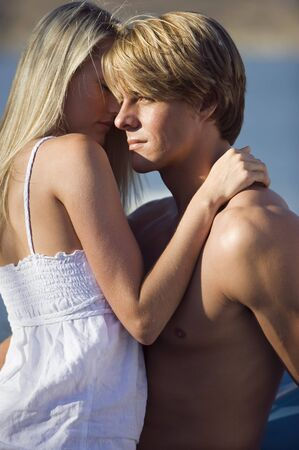 bare waist: Affectionate teenage couple (17-19) embracing, profile