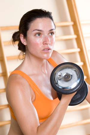 exertion: Woman with dumbbell, close-up LANG_EVOIMAGES