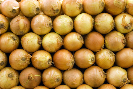 Selection of onions on display on market stall, close-up (full frame)