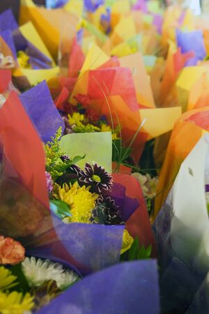differential focus: Multi-coloured flower bouquets on display in florists (differential focus)